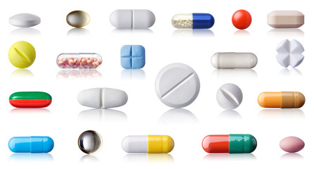 Set with different pills and capsules isolated on white