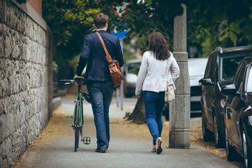 Business colleagues walking on sidewalk in city
