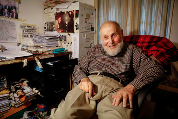 "Arthur Ashkin, who won the 2018 Nobel Prize for Physics for inventing ""optical tweezers"" poses in his home in New Jersey,"