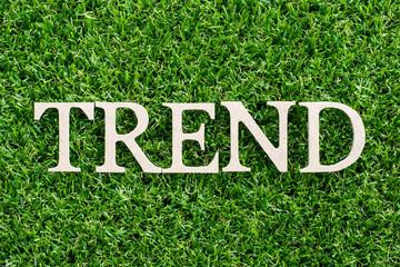 Wood letter in word trend on artificial green grass background