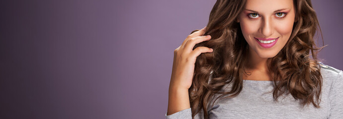 Beauty girl with long shiny hair, waves and curls volume hairsty