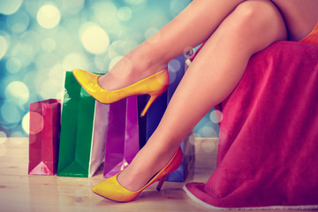Woman legs with various shopping bags