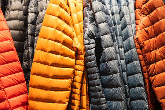 Colorful winter sports jacket on a hanger in the store
