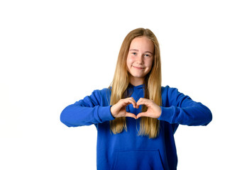 Young teen girl on white background showing heart sign