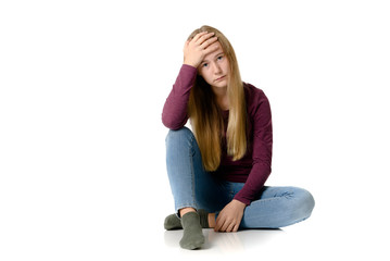 Young teen girl on white background, depressed, sad