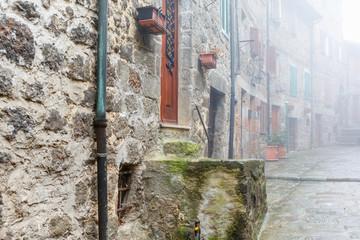 Foggy back street in an old village