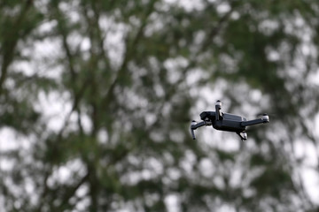 Drone Camera flying in the sky while the rain forests background