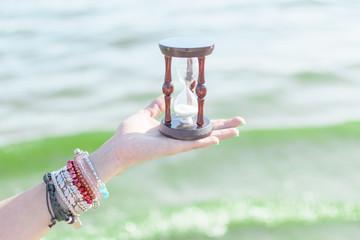 Hourglass in a female hand.