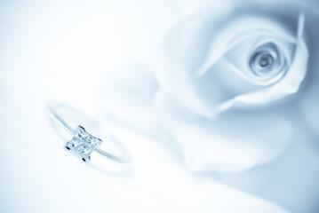 Modern diamond engagement ring (shallow depth of field, blue toned)