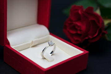 Modern diamond engagement ring in red jewellery box