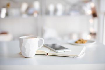 Modern white office, designer handmade cup of coffee, smartphone Fototapete