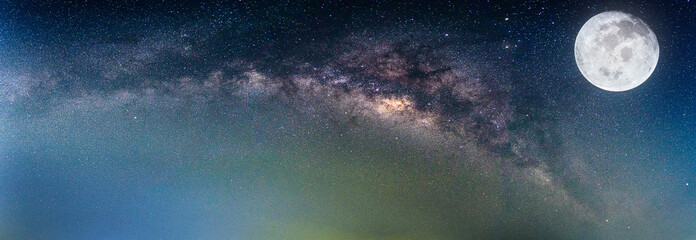 Wall Mural - Landscape with Milky way galaxy. Night sky with stars and the full moon. (Elements of this moon image furnished by NASA)