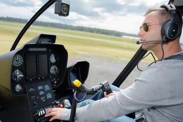 Pilot operating controls in cockpit
