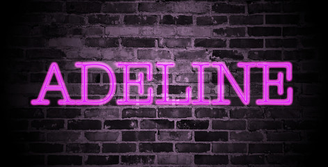 first name Adeline in pink neon on brick wall