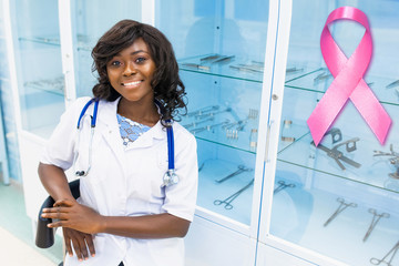 Healthcare, Medicine and Breast Cancer concept. Professional beautiful African female paramedic in the clinic. The concept of supporting awareness of a malignant tumor