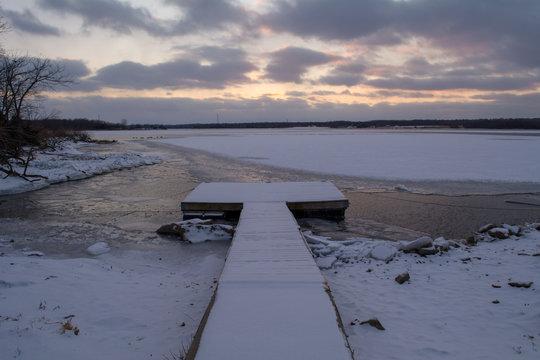 Wooden dock over frozen lake