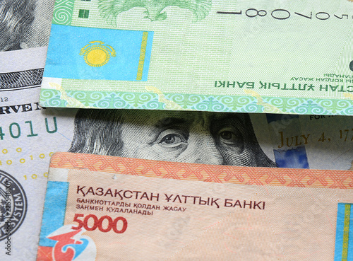 Kazakhstan Tenge And Dollars Banknotes Macro Background On Banking Devaluation The To Dollar Exchange Rate For Bussiness Sites Magazines