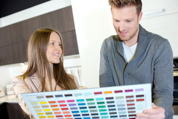 couple choosing paint colour from swatch