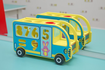 toy bus, multicolor car wooden blocks, transport over sky background . wooden toy bus