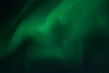 View at the northern lights in the night sky.