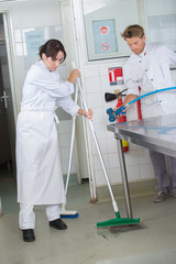 workers cleaning kitchen equipment