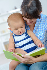 mother reading story to her baby