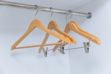 empty wardrobe with blank clothes hanger