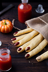 Halloween cookies Witch's fingers for party celebration. Wooden background.