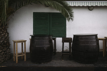 Old Wooden Barrels in Front of Old Restaurant with Palm Tree
