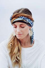Beautiful woman with kerchief on head looking at camera