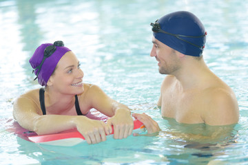 Swimming coach with female swimmer