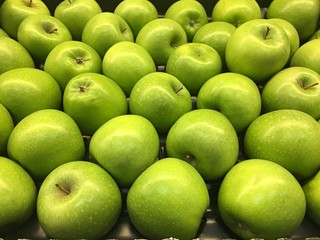 Juicy and smooth green apples in the store