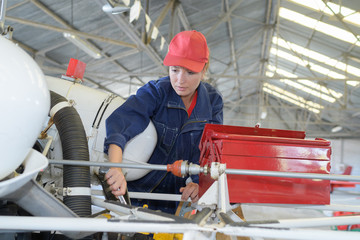 Female aviation mechanic at work