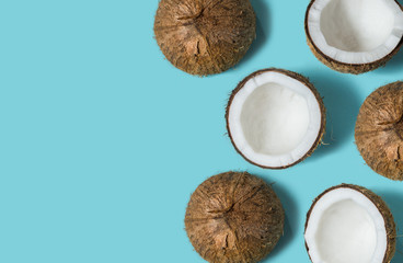 Top view of coconut isolated on blue background Summer concept. Flat lay. Pattern.
