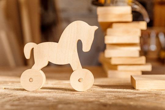 wooden toy in carpenter workshop