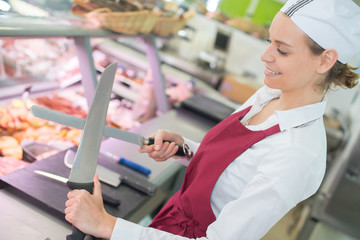 female butchers in a supermarket at work