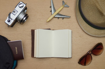 Travel objects flat lay on wooden table
