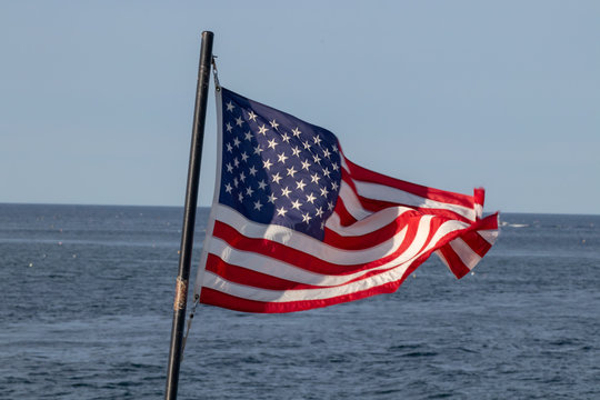Flag flying on a ship in a gusty wind