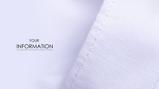 White shirt button fabric macro material clothes detail pattern on blur background