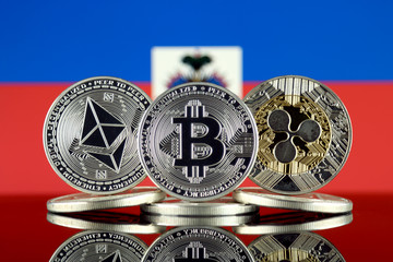 Physical version of Ethereum (ETH), Bitcoin (BTC), Ripple (XRP) and Haiti Flag. The Top 3 Cryptocurrencies by Market Cap.