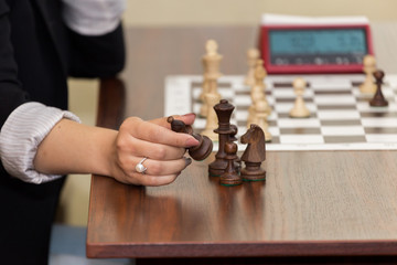 Woomen taking a piece in chess