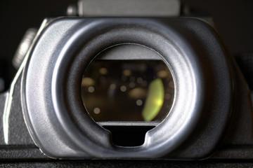 Camera's viewfinder on black background.