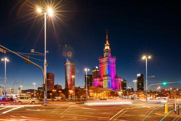 The Palace of Culture and Science and night traffic during rush hour.