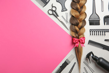 Flat lay composition with braid, hairdresser's tools and space for text on color background