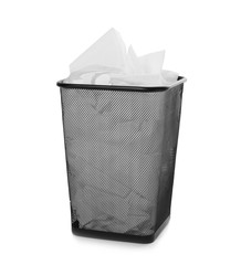 Trash bin with used toilet paper on white background
