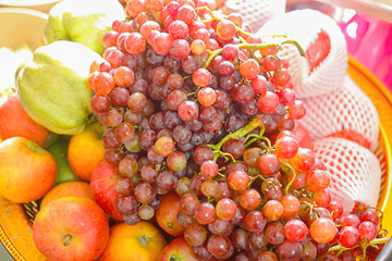 Grapes in tray and other fruits In the merit of relatives in Surat Thani Thailand