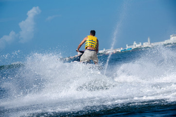 Man on a waverunner on the caribbean sea
