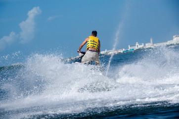 Man on a waverunner on the caribbean sea