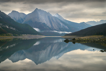 Medicine Lake, Alberta. Medicine Lake reflection of fresh snow on the surrounding peaks. Alberta, Canada.