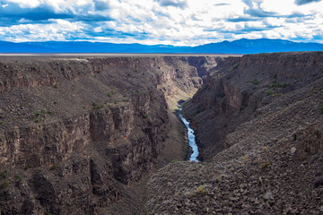 Rio Grande Gorge, looking south from the US Hwy 64 bridge over the 800' deep chasm, which lies on the Taos Plateau in New Mexico, paralling the Sangre de Cristo Mountains